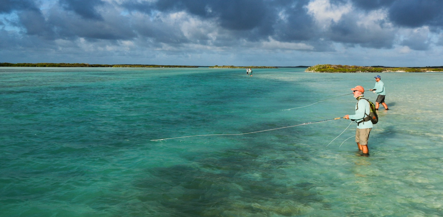 Wading for giant trevally with professional fly fishing guides at Alphonse Fishing Co™