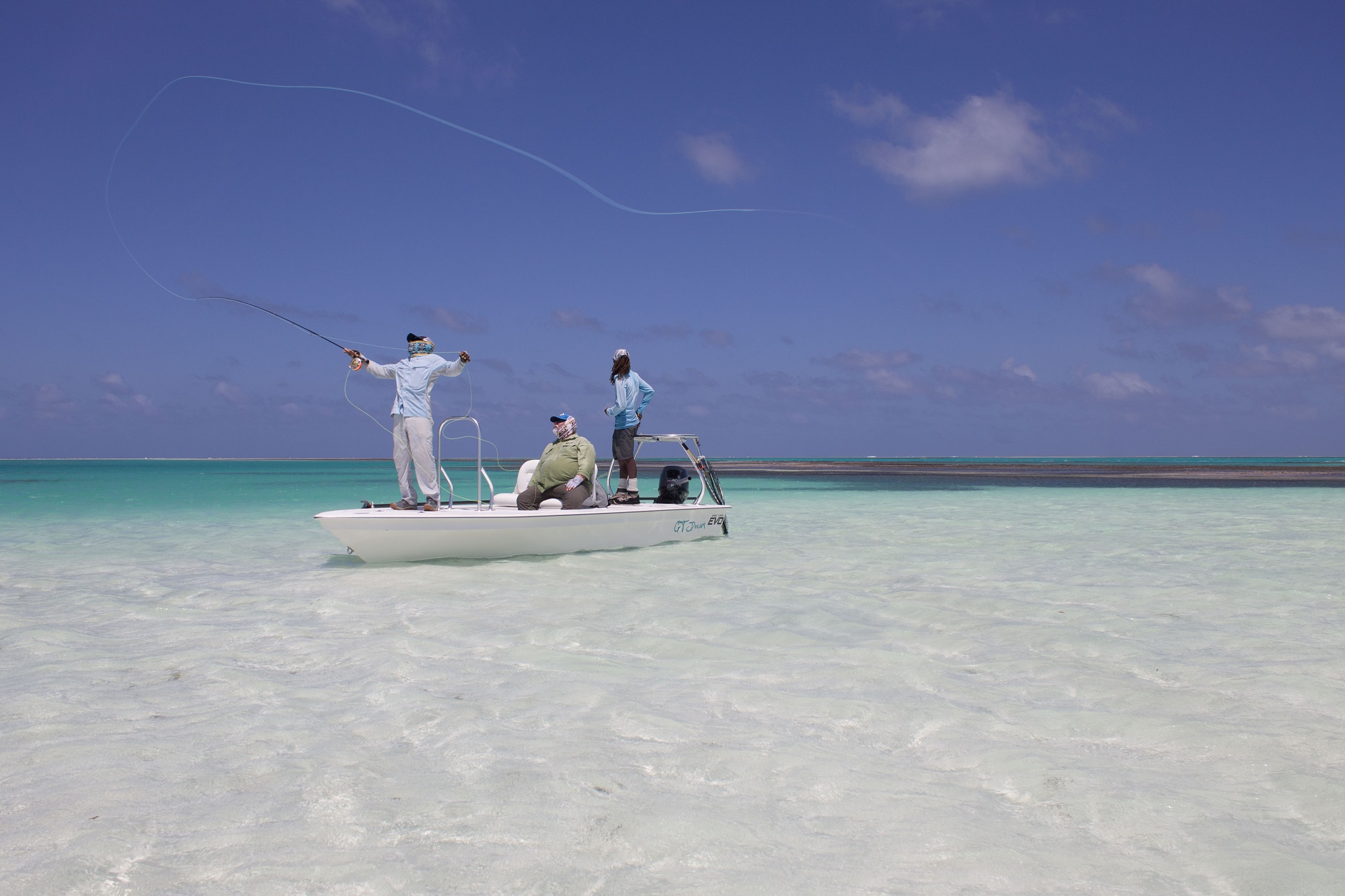 Fly fishing on a skiff with an Alphonse Fish Co™ guide