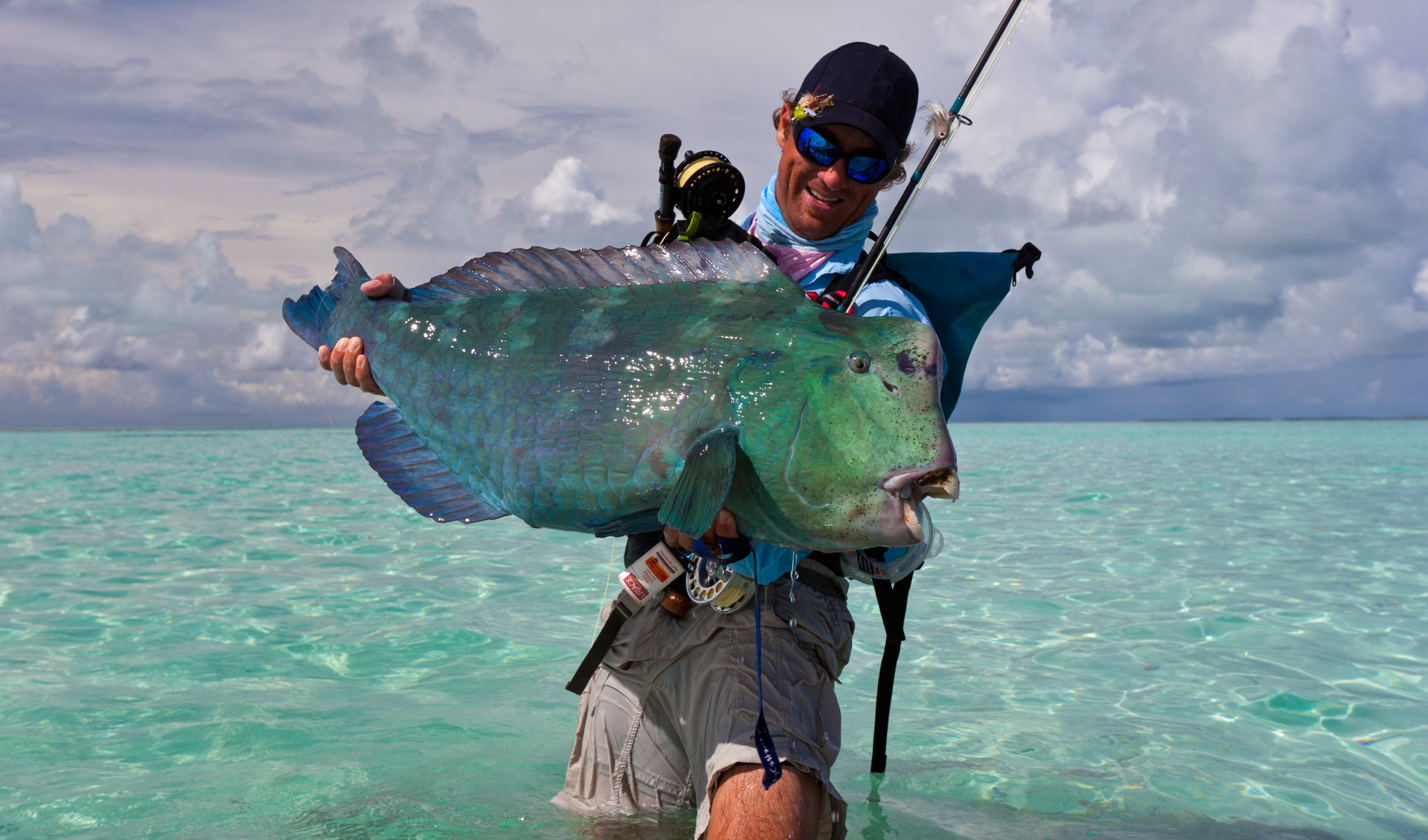 Keith holding this beautiful parrot caught on a fly at Farquhar atoll - saltwater fly fishing at its best