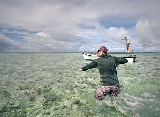 Fly fisher getting ready to fight the giant trevally on a fly with Alphonse Fishing Co™