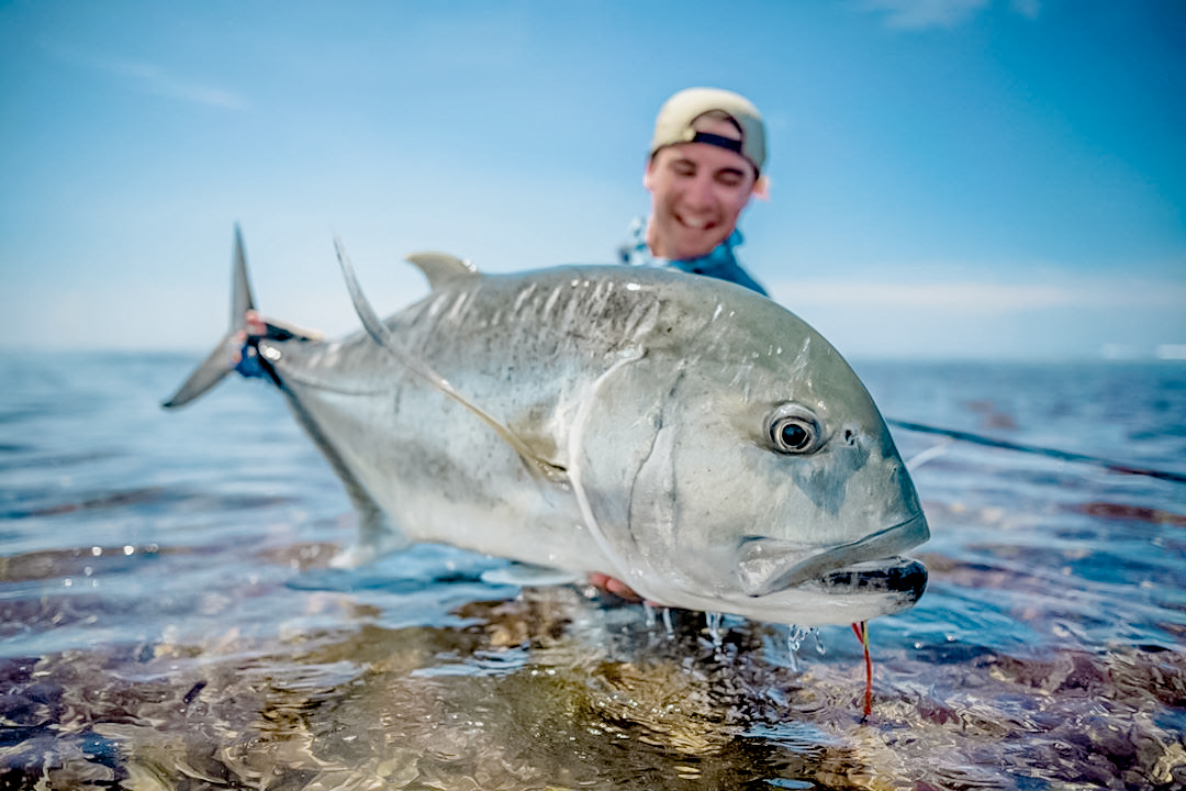 Super happy man caught giant trevally caught ion a flaming lamborghini fly with Alphonse Fishing Co™